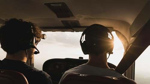 human closeup photo of two pilot and co pilot inside plane person