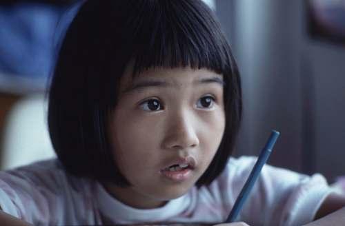 human girl holding pen girl