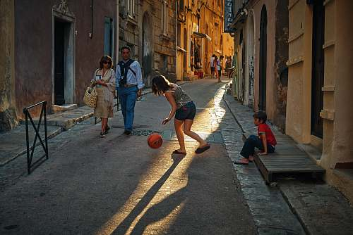 human girl playing ball person