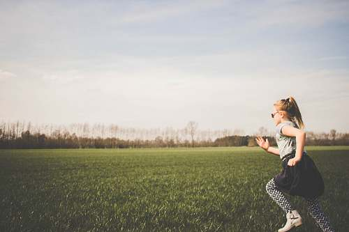 human girl running on grass field kid