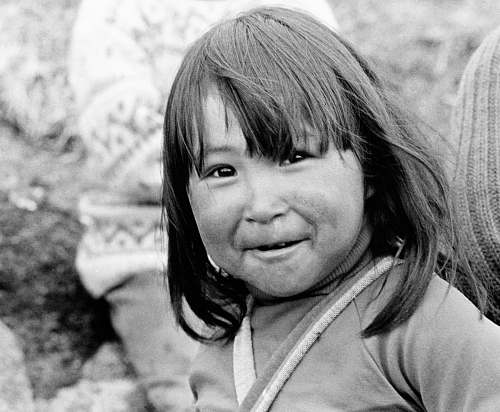 person girl smiling at the camera black-and-white