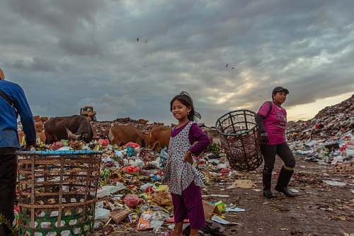 human girl standing near garbage person