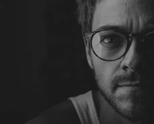 black-and-white grayscale photography of man portrait
