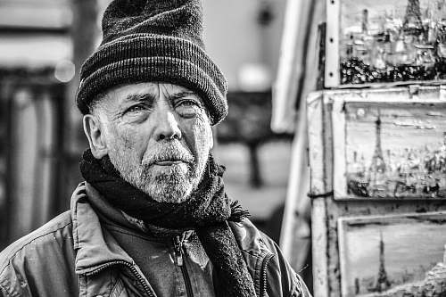 person grayscale photography of man with beanie cap and scarf black-and-white