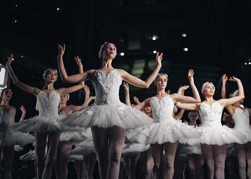 ballet group of ballerinas dancing while raising both hands dance