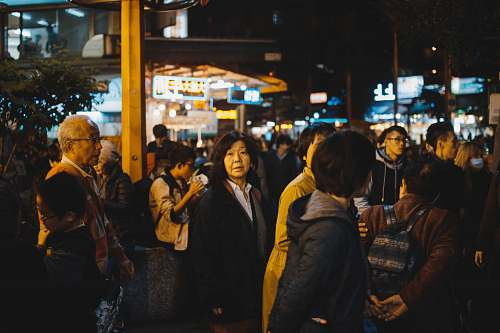 person group of people gathering on street during night time human
