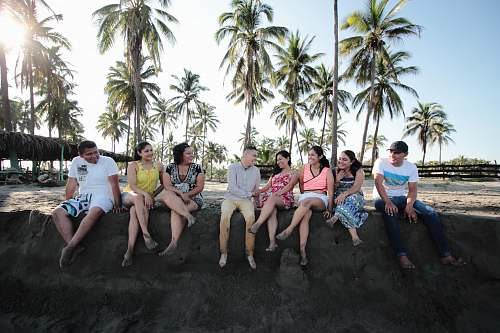 person group of people sitting on san human