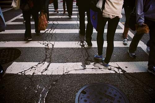 human group of person walking on pedestrian lane person