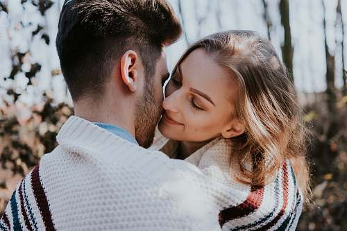 person man and woman kissing during daytime human