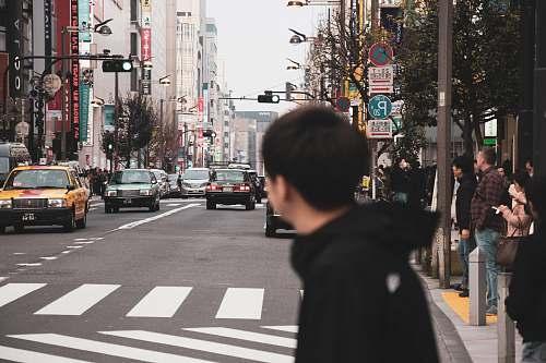 human man crossing pedesrtrian lane person