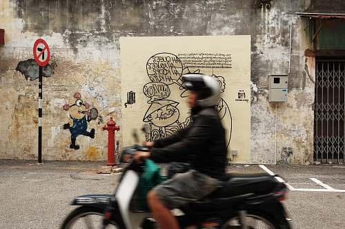 motorcycle man in black jacket riding Honda motorcycle transportation