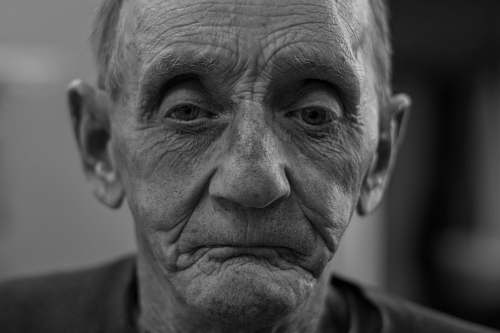 person man making sad face black-and-white