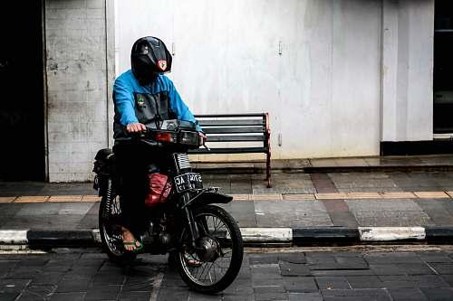 human man riding motorcycle motorcycle