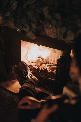 human man sitting in front of the fireplace person