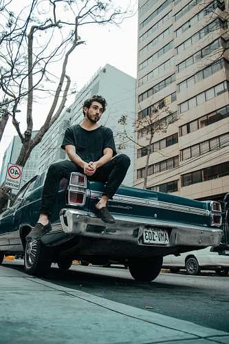 human man sitting on classic car person