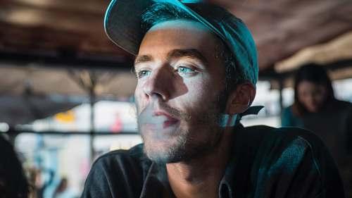 human man smoking person