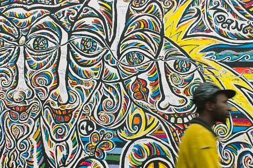 human man standing near graffiti art person