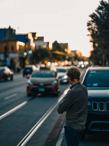 car man standing near vehicle vehicle