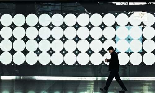 human man walking near lights person