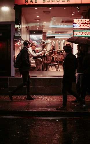 restaurant man walking near restaurant wearing jacket food