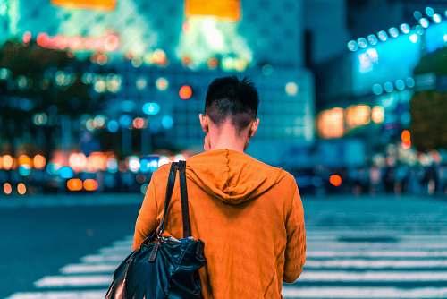human man walking on pedestrian lane person