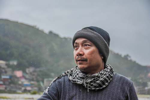 person man wearing black knit cap looking left human