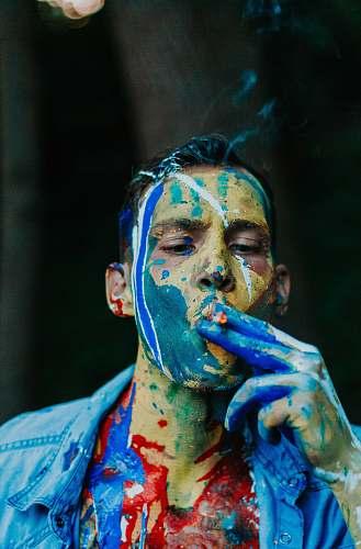 human man wearing blue shirt while smoking person
