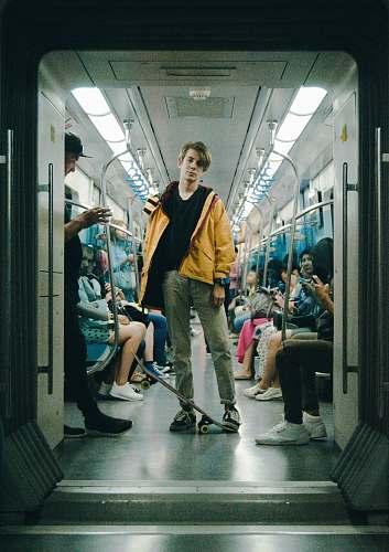 human man wearing gray pants inside train person