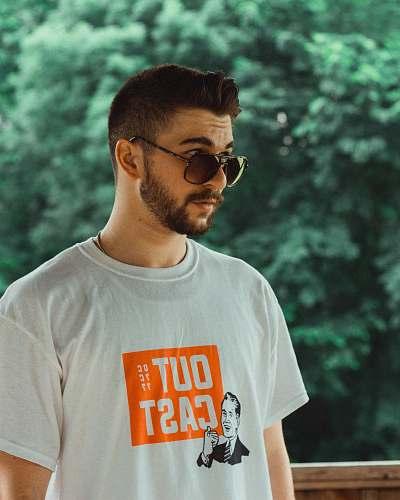 person man wearing white and orange crew-neck t-shirt clothing