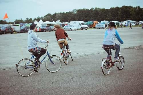 human people riding bicycle bike
