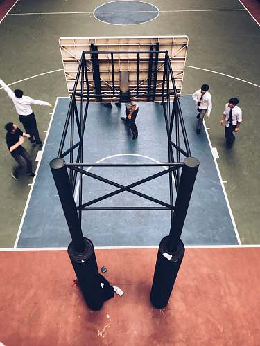 human people standing under basketball hoop person