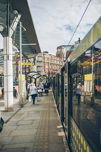 pavement people waling on train station sidewalk