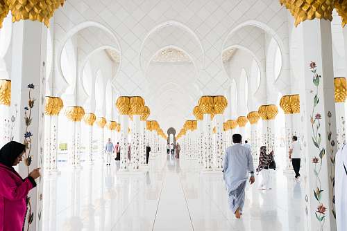 human people walking on pathway inside building person