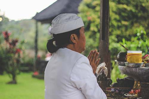 human person praying in front of table person