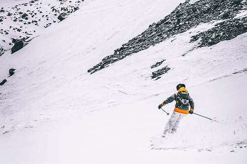 person person skiing on snow at daytime skiing