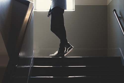 person person standing on in a dim-lit stair human