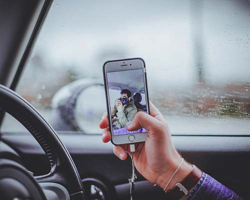 person person taking selfie inside the car human