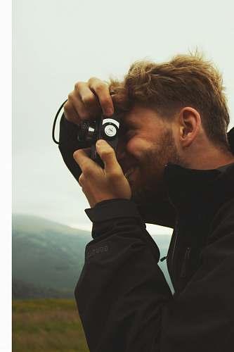 human person using black camera person