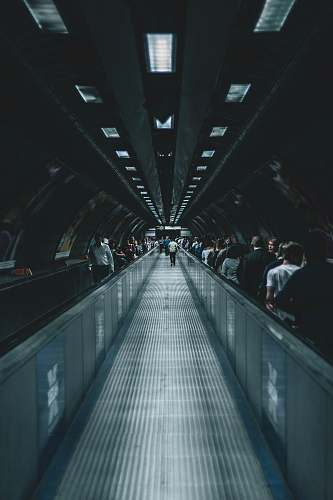 human person waking on escalator person