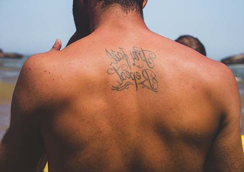 person person with try fail repeat tattoo at back human