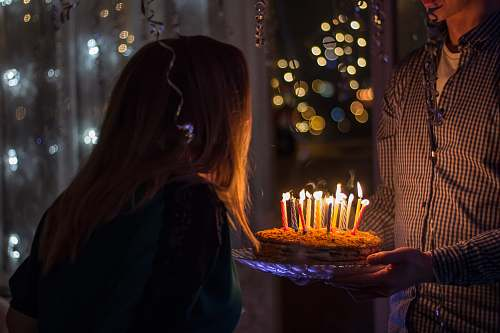 human photo of birthday birth about to blow birthday candles cake