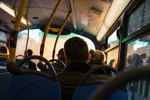 human photo of man sitting inside bus person