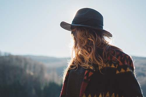 human photo of person with blonde hair wearing hat staring at horizon hat