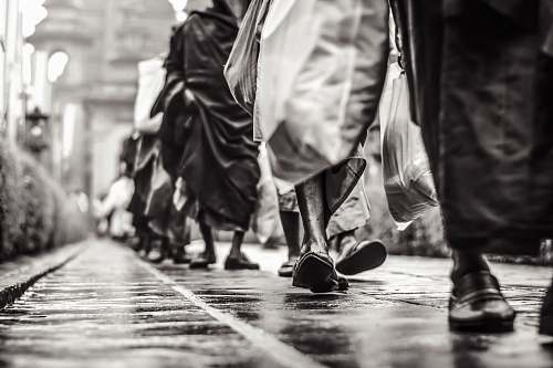 human selective focus graysclae photography of people walking on street person