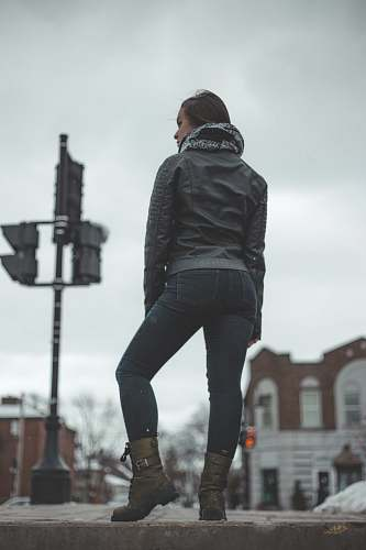 human selective focus photo of woman standing on roadway grey