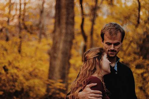 human selective focus photography of man and woman person