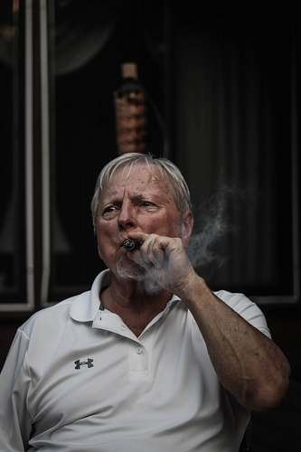 human selective focus photography of man using tobacco person