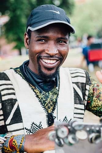 human smiling man wearing black Nike baseball cap person