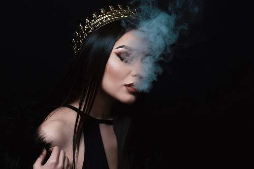 human smoke coming out from woman's mouth person