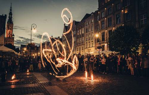 human time-lapse photography of fire dancing person